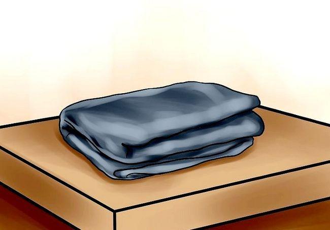 एक अग्निरोधी कंबल का उपयोग कैसे करें